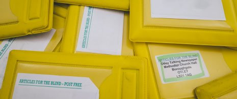 Photograph of yellow postage wallets